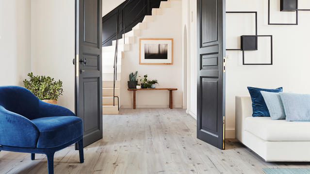 New wood and stone effect laminate floors that offer a perfect easy lay and easy maintenance alternative to hardwood floors